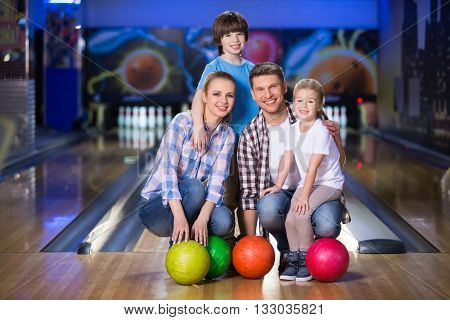 Smiling family with child in bowling