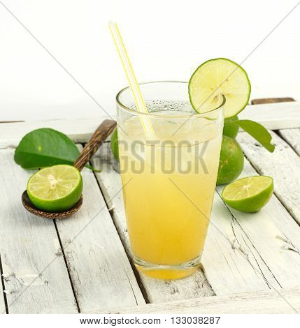 Glass Of Lime Juice With Ice On White Wood