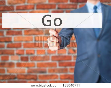 Go - Businessman Hand Holding Sign
