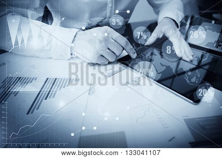 Account Department Work Online Process.Photo Trader working Market Report Document Touching Screen Tablet.Using Graphics, Stock Exchanges Reports, Digital Interfaces.Business Project Startup.Black white