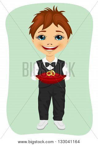 Little boy holding wedding rings on cushion. Ring bearer isolated on green background