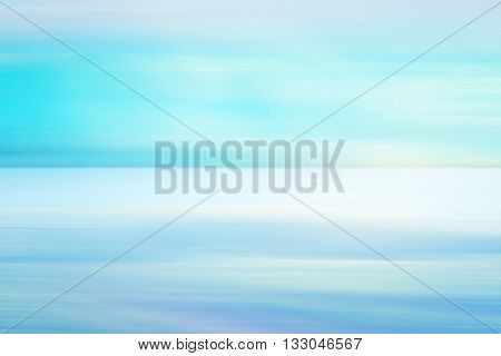 Blue light background with calm ocean and sky