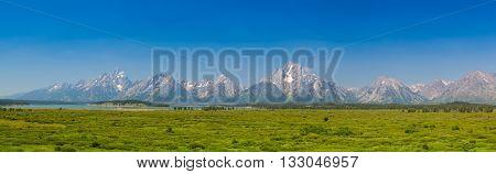 Panorama landscape - The amazing Teton mountains above Jackson Lake in Wyoming USA.