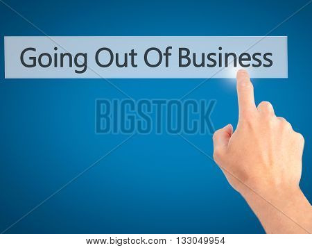 Going Out Of Business - Hand Pressing A Button On Blurred Background Concept On Visual Screen.