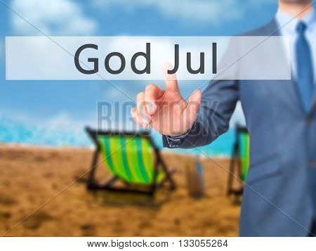 God Jul (merry Christmas In Swedish) - Businessman Hand Pressing Button On Touch Screen Interface.