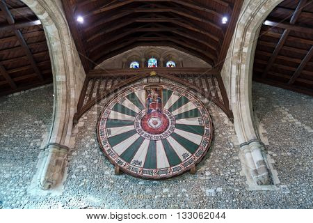 WINCHESTER, UK - FEBRUARY 07: Spotlights in ceiling on sign of the knights of the round table in the historic medieval castle of Winchester in the United Kingdom. Winchester, UK on February 08, 2016.