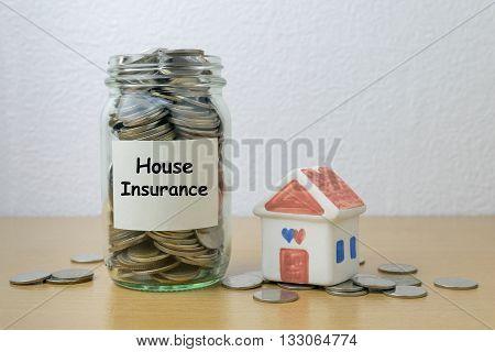 Money saving for house Insurance in the glass bottle