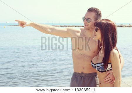 Young couple posing next to the beach