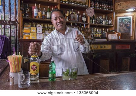 Havana, Cuba - january 20, 2016: Bartender in the Bodeguita del Medio, serving mojitos in Havana , Cuba