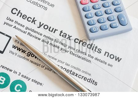 WREXHAM UNITED KINGDOM - JUNE 6 2016: Renewing an annual British working tax credit and national living wage concept