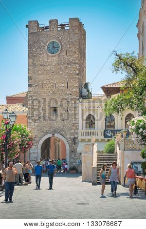 TAORMINA, ITALY - JULY, 2: people on Piazza IX Aprile near Chiesa di san Giuseppe, in Taormina, Sicily on July 2, 2015. the church was built between late 1600 and early 1700 in Baroque style.