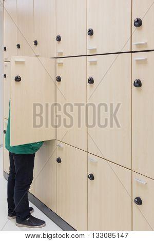 business man opening Modern wood Interior of a locker