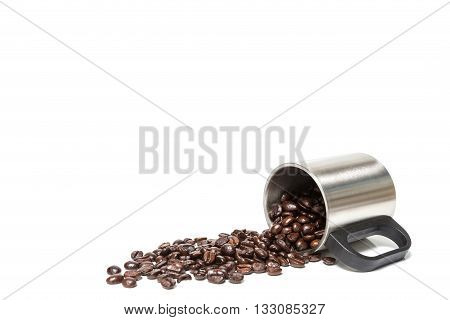 Coffee beans in stainless coffee cup isolated on white background