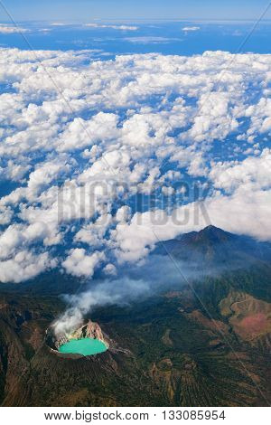 Aerial photo of active volcano Ijen in East Java - largest highly acidic crater lake in world with turquoise sulphuric water. Site of sulfur mining. Famous travel destinations of Indonesian islands.