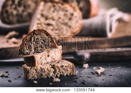 Bread. Fresh bread. Homemade traditional bread. Sliced bread crumbs knife and cumin.