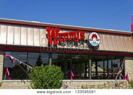 Indianapolis - Circa June 2016: Wendy's Retail Location. Wendy's is an International Fast Food Restaurant Chain I