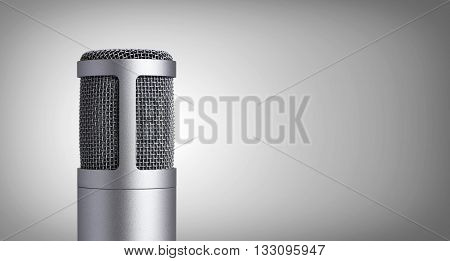 Vintage metal microphone on a gray background