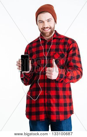 Smiling handsome berded man holding mobilephone and showing okay gesture isolated on the white background