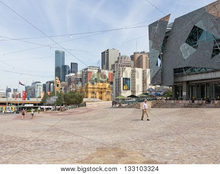 Melbourne - February 23 2016: People walk at Federation Square on a hot day near the station Flinders Street Station February 23 2016 Melbourne Australia