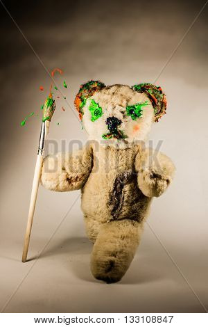 Teddy bear as a wizard holding paintbrush as a magic staff