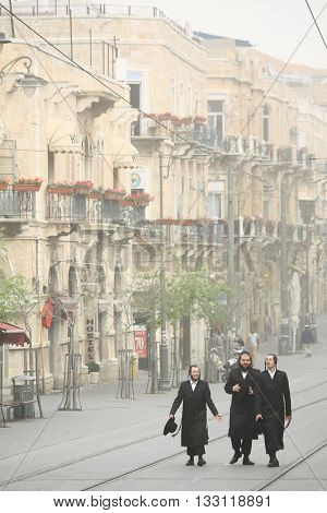 JERUSALEM, ISRAEL, 1 APRIL 2013. Editorial Photograph of Orthodox Jews walking up Jaffa Street.  Most businesses, shops and restaurants close for the Sabbath, leaving the streets eerily quiet.