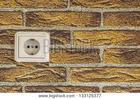 white power switch on the orange brick photo wallpaper background