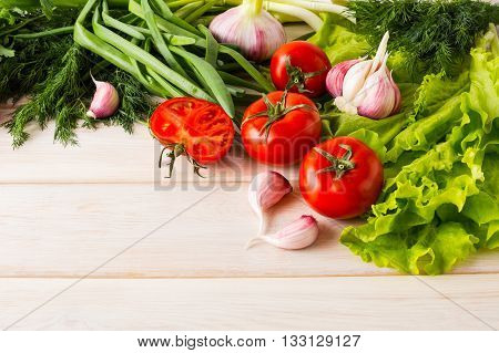 Fresh tomato and garlic place for text. Healthy eating concept. Vegetarian food. Healthy eating. Ripe vegetables. Fresh vegetables.