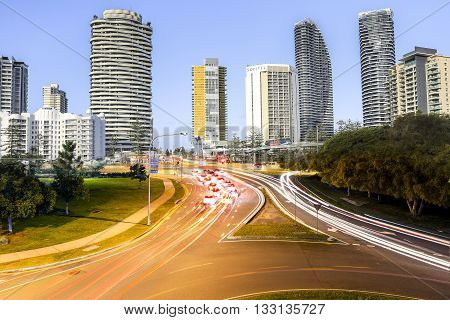 GOLD COAST, AUSTRALIA - AUGUST 29 2014: Day to night transition of Broadbeach day cityscape and night traffic trails