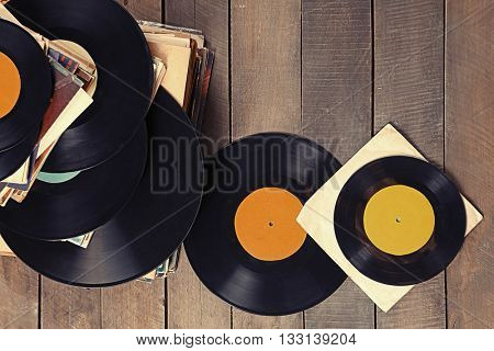 Pile of old vinyl records on wooden background