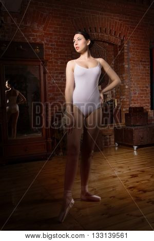 Young Ballerina Standing On Poite