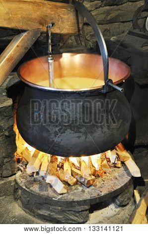 Making of Swiss cheese
