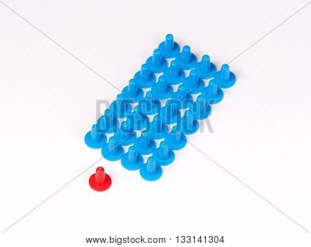 Illustration of a group in formation lead by a singled by colored plastic board game hats in various colors