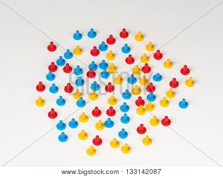 Random group illustrated by colored plastic board game hats in various colors