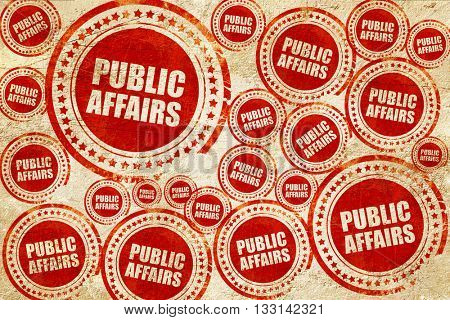 public affairs, red stamp on a grunge paper texture