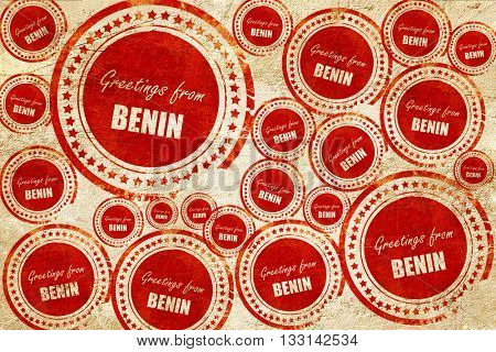 Greetings from benin, red stamp on a grunge paper texture