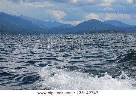 rapid water flowing behind boat on the lake