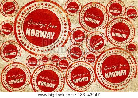 Greetings from norway, red stamp on a grunge paper texture
