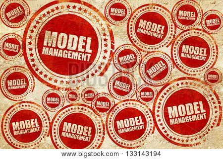 model management, red stamp on a grunge paper texture