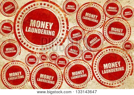 money laundering, red stamp on a grunge paper texture