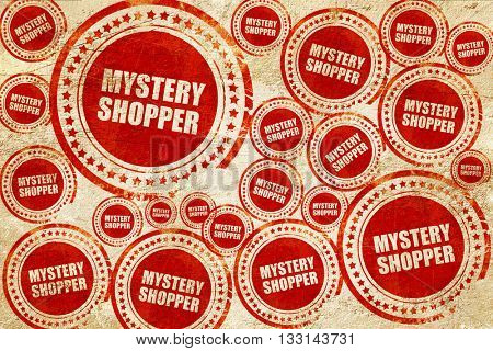 mystery shopper, red stamp on a grunge paper texture