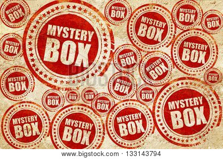 mystery box, red stamp on a grunge paper texture