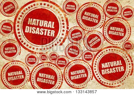natural disaster, red stamp on a grunge paper texture