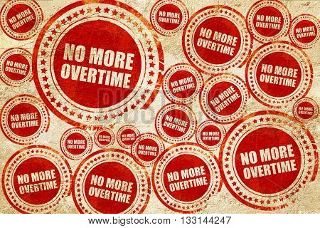 no more overtime, red stamp on a grunge paper texture