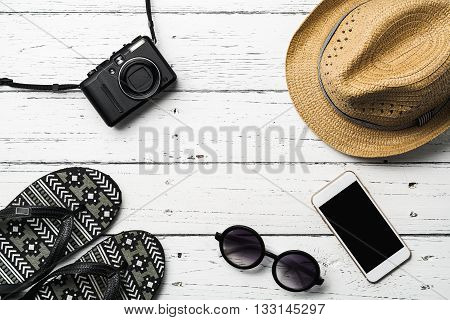 Summer holiday background Beach accessories on table Vacation and travel items