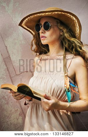 Female Sunglasses Outdoors Reading Book Concept