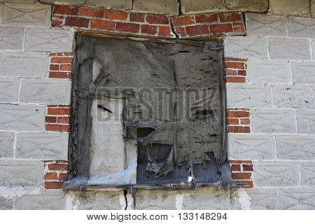 Old ruined house window.