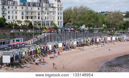 Torquay United Kingdom - June 21 2015: Families enjoy a day at the beach huts on Torquay Beach England