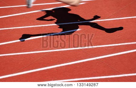 Motion blurred runners shadow, track and field race
