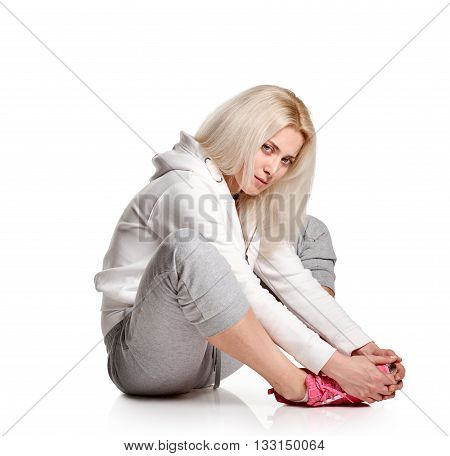 sitting Fitness woman relax on white background