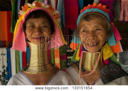 CHIANG MAI, TAILAND - APRIL 22, 2016: A portrait of a woman from Kayan Lahwi tribe known for wearing neck rings, brass coils to extend the neck. Kayan, Red Karen (Karenni).